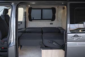 Seating folded down in the Volkspec Leisure Delphi campervan
