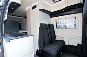 Westfalia James Cook has more curves in the furniture and black accents that help to blend the cab into the rest of the campervan