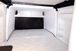 The lengthways double bed with the rear slide out deployed in the new Westfalia James Cook