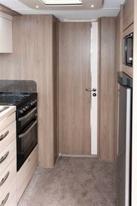 When this door is closed the bedroom and washing facilities form a cohesive en suite arrangement