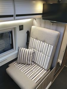 One of the travel seats in the WildAx Aurora campervan