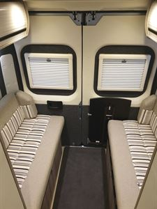 The side-facing settees in the WildAx Aurora campervan