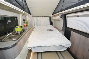 The bed in the WildAx Proteus campervan