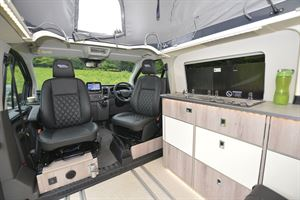 A view of the cab seats in the WildAx Proteus campervan