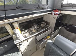 The kitchen in the WildAx Triton campervan