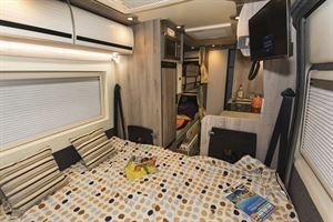 The double bed in the Wildax Solaris XL campervan