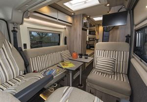 Seats and dining table in the Wildax Solaris XL campervan