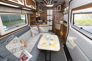 The lounge area with table out in the IH 680 CFL campervan