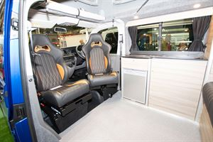 Front seats turned to face the interior of the Rolling Homes Expedition campervan