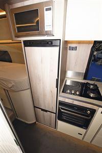 The kitchen, with fridge beside it, in the WildAx Elara campervan