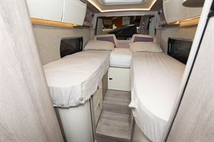Twin single beds in the WildAx Elara campervan