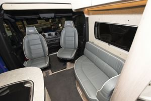 The lounge seating in the WildAx Elara campervan
