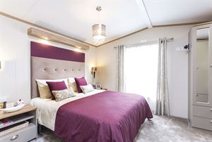 A bedroom in the Abingdon holiday home at Grange Country Park, near Colchester