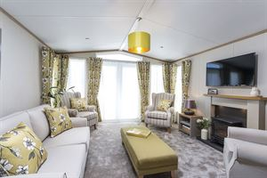 The lounge in the Abingdon holiday home at Grange Country Park, near Colchester