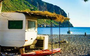 Caravan on a beach - licensed through Canva.com