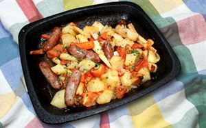 Cooking in a caravan: Roasted sausages with parsnips