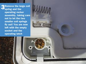 Motorhome Door Lock DIY 3: Remove the large coil spring and the operating rocker assembly, taking care not to let the two smaller coil springs fly out! You are now left with the empty socket and the operating latch