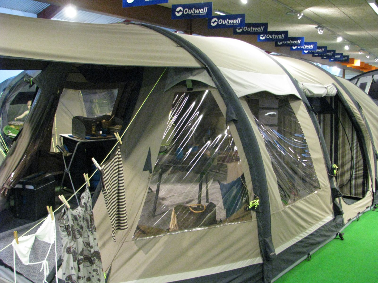A six-berth polycotton inflatable tent with a zip-off canopy that provides shelter and shade and extends the already large living area. & Outwell 2015 Tents - Out and About Live