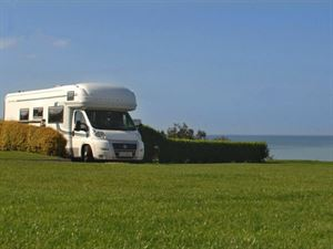 Motorhome pitches are offered on grass and hardstandings