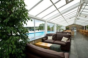 Enjoy a drink in the terrace area with a view over the outdoor pool