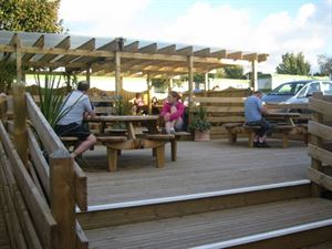 Decked area is next to the bar and restaurant