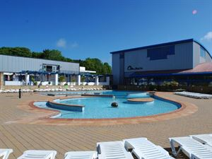Outdoor pool is the place to relax in the sun