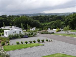 Large hardstanding pitches for tourers, with countryside views