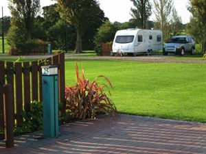 Deluxe All Weather fully serviced pitches include water, waste water, 16amp electric, lighting, TV & Satellite connections too!