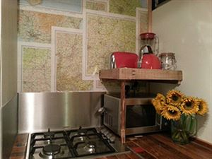 The gas hob with maps on the wall