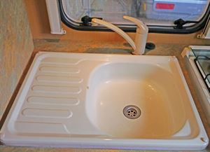 The original seized tap and chipped and worn enamel sink.