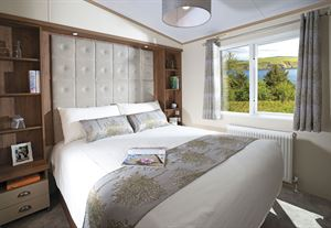 The main bedroom in the Regal Somerton at Oaklands Park in Cornwall