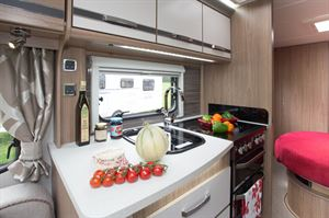 We love VIP kitchen styling for 2016, with a gleaming white surface and brown-shade glossy splashbacks