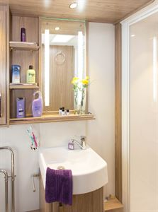 Style and practicality. A deep Belfast-style basin. lots of shelving and lights set into the mirror