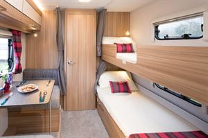 """The cosy bunk """"bedroom"""" is integrated with the dining area"""