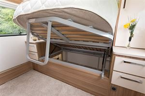 The bed rises to reveal lots of floor space and a rear storage area