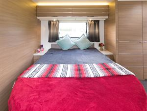 Lighting above the lockers and spotlights to focus on the silver stripes in the curtains; this is a superb bedroom