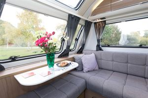 The coffee table hinged at the front of the caravan is 76cm wide and 35cm deep